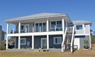 Smith coastal modern piling home on Navarre Beach by Acorn Fine Homes - Thumb Pic 9