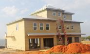 Modern coastal piling home in Navarre by Acorn Fine Homes - Thumb Pic 7