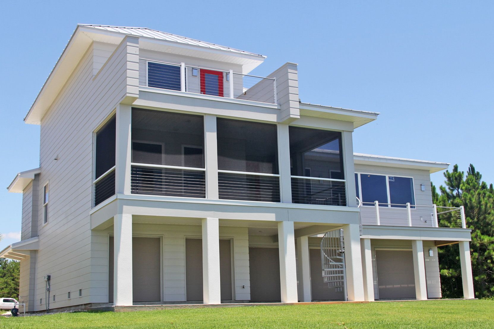 Modern piling home in Navarre by Acorn Fine Homes